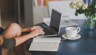 woman typing at laptop #Blogtober2020
